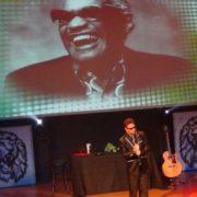 As Ray Charles!