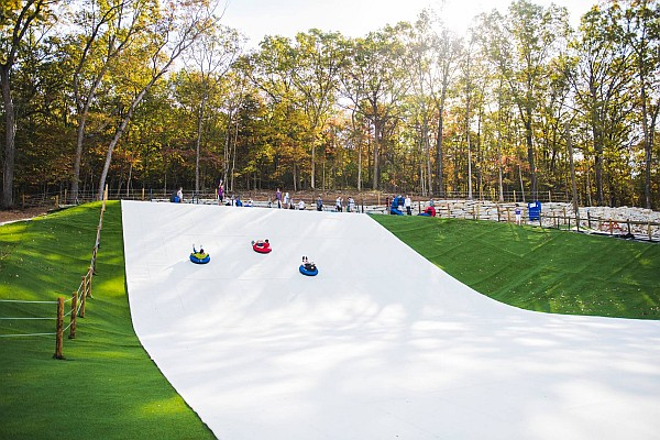 Branson's new SnowFlex at Wolfe Mountain is the largest synthetic snow tube attraction in the United States!