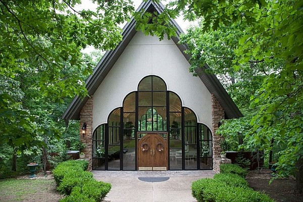 Stonegate Glass Chapel offers one of the most beautiful settings in the Ozarks for a wedding.